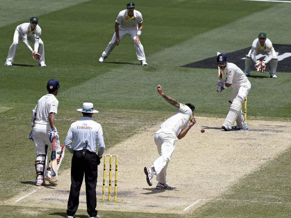 Johnson bowls to Kohli during a Test in Melbourne in December 2014