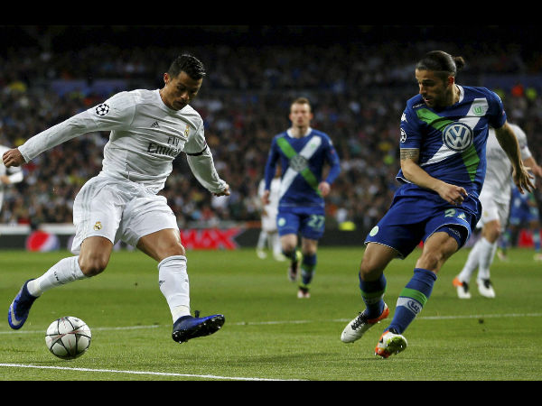 Real Madrid's Cristiano Ronaldo fights for the ball against Wolfsburg's Ricardo Rodriguez during the Champions League 2nd leg quarterfinal soccer match between Real Madrid and VfL Wolfsburg