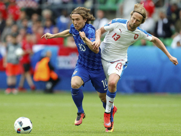 Croatia's Luka Modric, left, and Czech Republic's Jaroslav Plasil vie for the ball during their Euro 2016 match