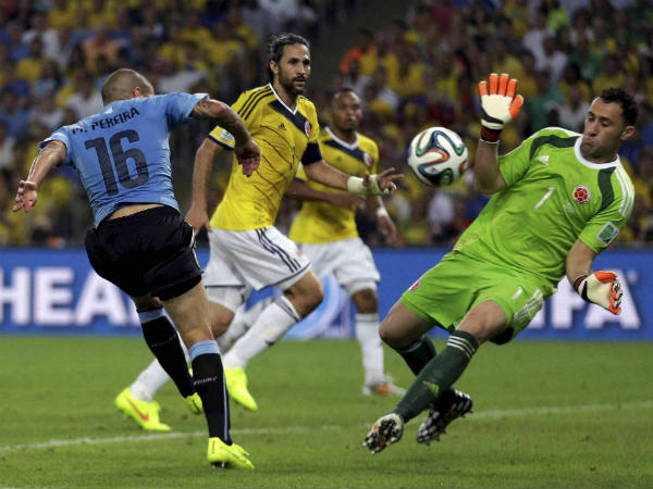 File photo: Colombia's goalkeeper David Ospina (right) makes a save from Uruguay's Maxi Pereira during the World Cup round of 16 soccer match in 2014
