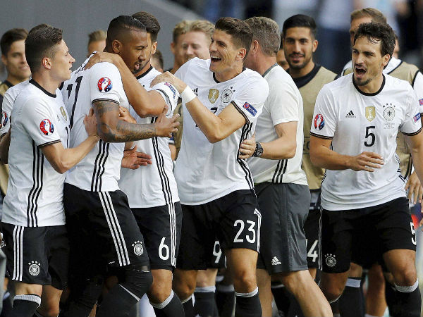 Germany's Jerome Boateng celebrates with teammates after scoring his side's first goal during the Euro 2016 round of 16 soccer match between Germany and Slovakia, at the Pierre Mauroy stadium in Villeneuve d'Ascq, near Lille, France, on June 26, 2016.
