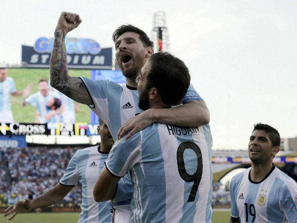 File photo: Argentina's Lionel Messi, top, celebrates a goal by Gonzalo Higuain (9) during the first half of a Copa America Centenario quarterfinal soccer match against Venezuela on Saturday, June 18