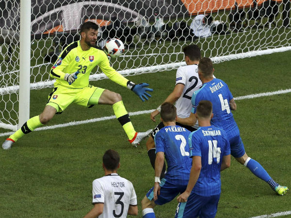 Germany's Mario Gomez, background right, scores his side's second goal besides Slovakia goalkeeper Matus Kozacik, left, during the Euro 2016 round of 16 soccer match between Germany and Slovakia, at the Pierre Mauroy stadium in Villeneuve d'Ascq, near Lille, France, on June 26, 2016.