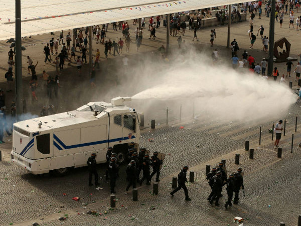 Police fire water cannons to control the fighting fter football fans clashed ahead of the England v Russia Euro 2016 soccer match, in Marseille, France, Saturday June 11, 2016