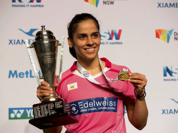 File photo: Saina poses with her Australian Open title this year