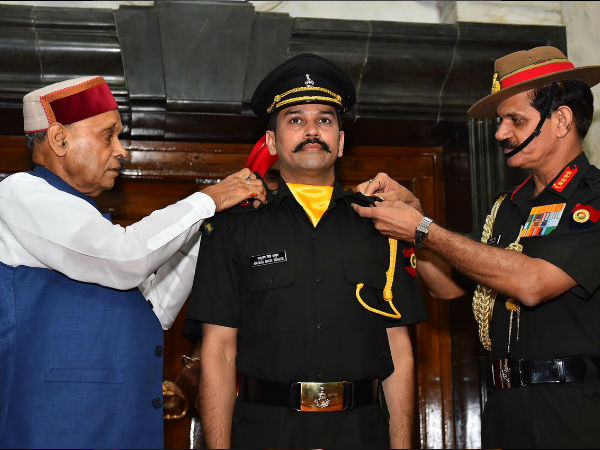 Thakur's proud father PK Dhumal