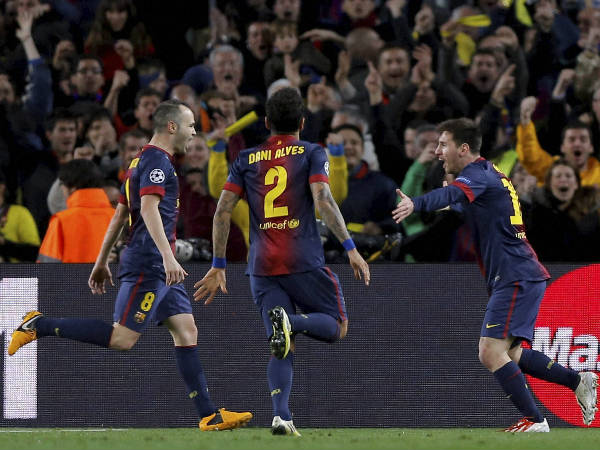 File photo: Barcelona's midfielder Andres Iniesta, left, defender Daniel Alves, from Brazil, centre, and forward Lionel Messi, from Argentina, celebrate Messi's second goal during the Champions League