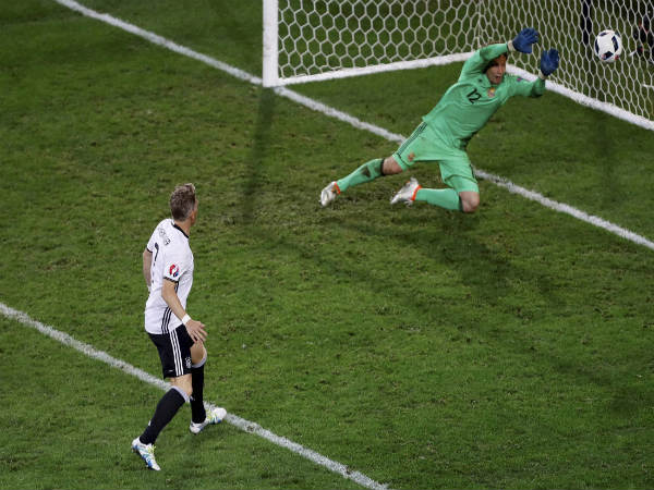 Bastian Schweinsteiger (white) netting the winner against Ukraine