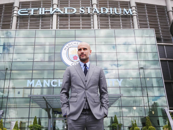 Pep Guardiola in front Etihad stadium as Manchester City manager (Image courtesy: Manchester City twitter handle)