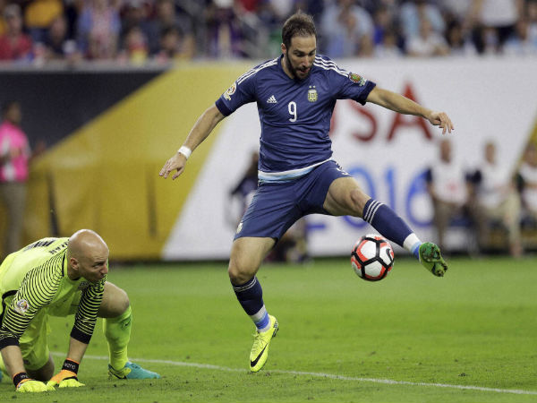 Gonzalo Higuain (right) scorers a goal for Argentina
