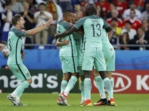 Portugal's Nani, centre, celebrates after scoring his side's second goal during the Euro 2016 semifinal soccer match between Portugal and Wales, at the Grand Stade in Decines-Charpieu, near Lyon, France, on July 6, 2016.