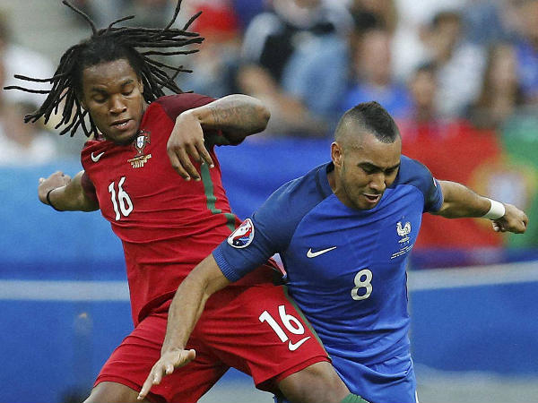 Renato Sanches (left) challenges Dimitri Payet for the ball in Euro final