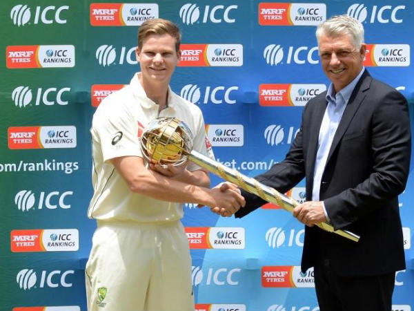 Smith (left) receives the Test mace from Richardson