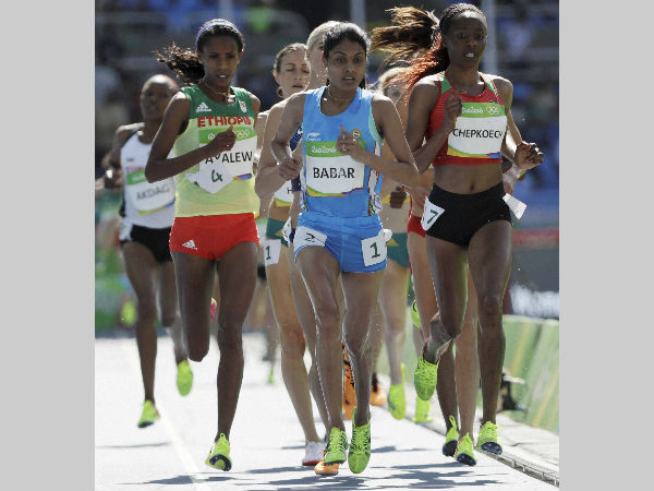 Lalita Babar (in blue), centre, competes in a women's 3000-metre steeplechase heat at Rio Olympics