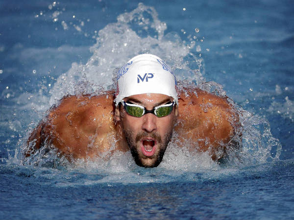 Michael Phelps competes in the 200-meter butterfly final at the Arena Pro Swim Series swim meet