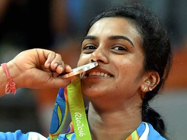 Sindhu kisses her Olympic medal