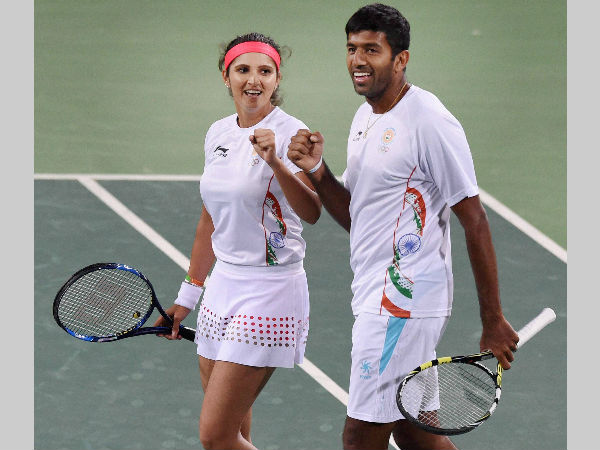 Sania Mirza (left) and Rohan Bopanna celebrate after beating Andy Murray and Heather Watson of Great Britain to enter semi-finals of mixed doubles at Rio Olympics on Friday (August 12)
