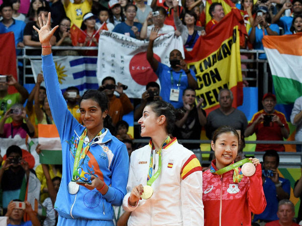 (L-R) Silver medalist V. Sindhu Pusarla of India, gold medalist Carolina Marin of Spain and bronze medalist Nozomi Okuhara of Japan celebrate during the medal ceremony after the Women's Singles Badminton competition on Day 14 of the Rio 2016 Olympic Games at Rio de Janeiro.