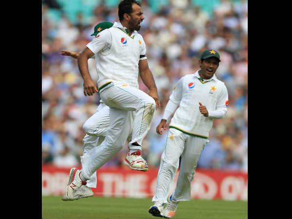 Pakistan's Wahab Riaz, left, celebrates taking the wicket of England's James Vince for 1, during day one of the Fourth Test match between England and Pakistan at The Oval in London.
