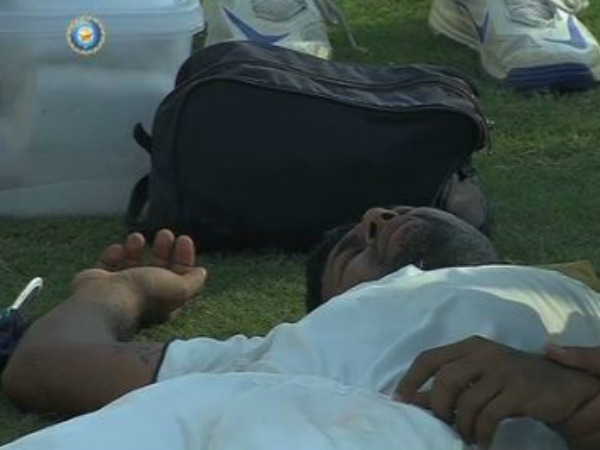 Pragyan Ojha lies on the ground after suffering a head injury. Screen grab from BCCI video
