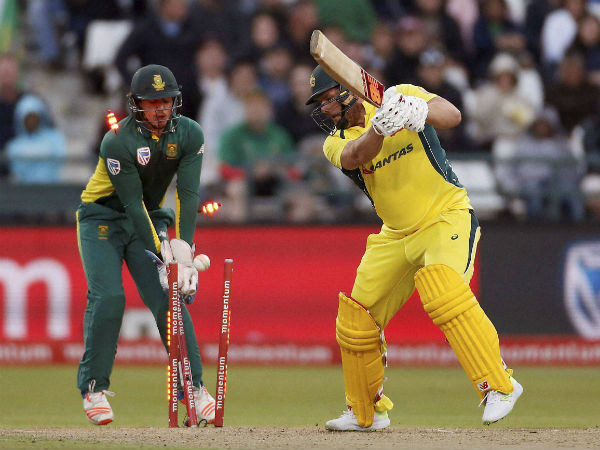 Australia's Aaron Finch, right, loses his wicket during their 5th One Day International, against South Africa in Cape Town, South Africa