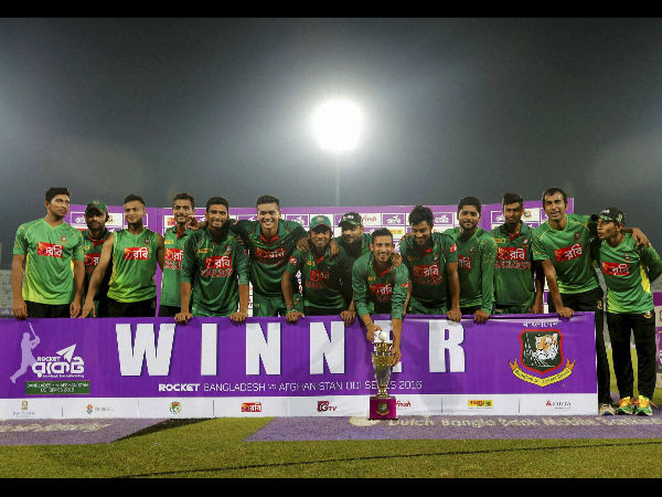Bangladesh's players pose with the trophy after winning their series against Afghanistan in Dhaka, Bangladesh, Saturday, Oct. 1, 2016.