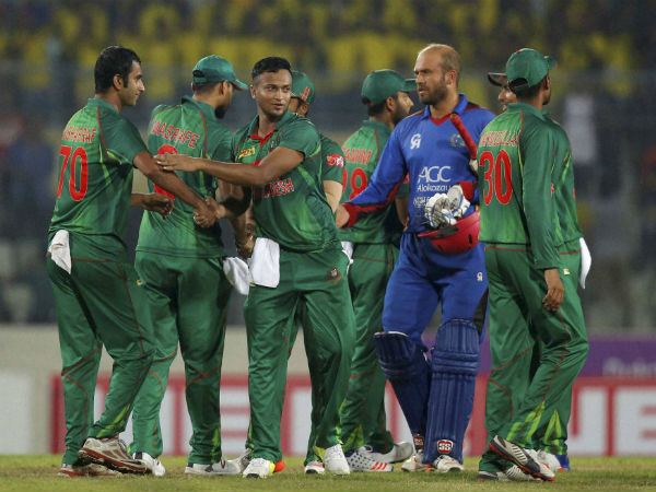 Bangladesh's cricketers celebrate their victory over Afghanistan at the end of the third one-day international cricket match in Dhaka, Bangladesh, Saturday, Oct. 1, 2016