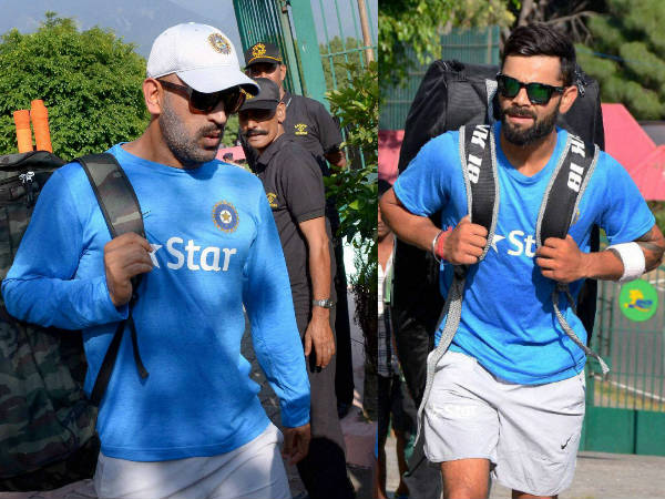 Captain Dhoni (left) and Kohli arrives for practice at HPCA Stadium in Dharamsala on Friday (October 14)