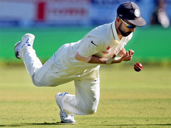 Indian player Ajinkya Rahane drops a catch of England batsman Alastair Cook during day 1 of the first test match in Rajkot on Wednesday.