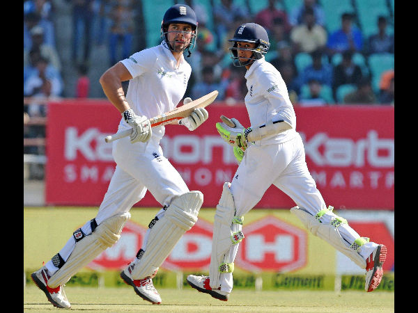 File photo: Hameed (right) runs with Alastair Cook during the 1st Test against India in Rajkot