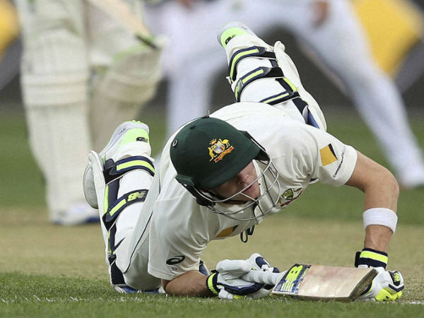 Australia's Steven Smith dives back to his crease during an attempted run out during their cricket test match against South Africa in Hobart.