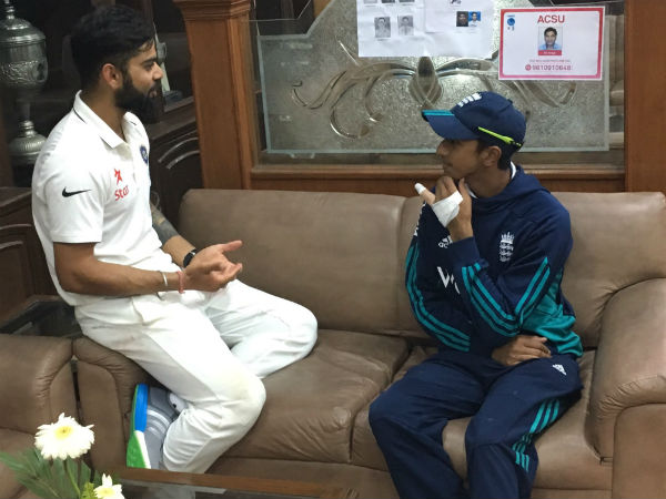Kohli (left) talks to Hameed after the match. Picture from BCCI's Twitter page