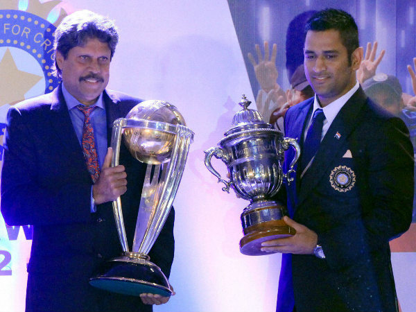 File photo: Kapil (left) and Dhoni after exchanging their World Cup trophies