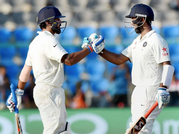 Vijay-Pujara put up 107-run partnership