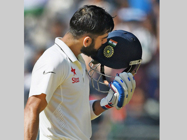 Virat Kohli kisses his helmet after reaching 200 in the 4th Test against England in Mumbai