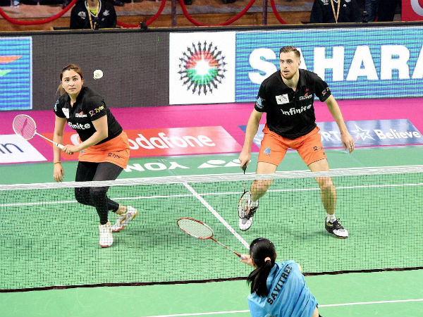 Jwala Gutta and Vladimir Ivanov of Delhi Acers in action against Awadhe Warriors during the Premier Badminton League match at Babu Banarsi Das Badminton stadium in Lucknow on Thursday.