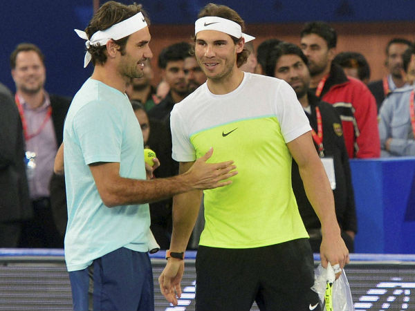 File photo: Federer and Nadal together after a match