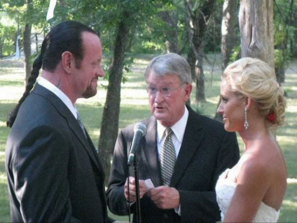 Undertaker with his wife, Michelle McCool (Image courtesy: Youtube)