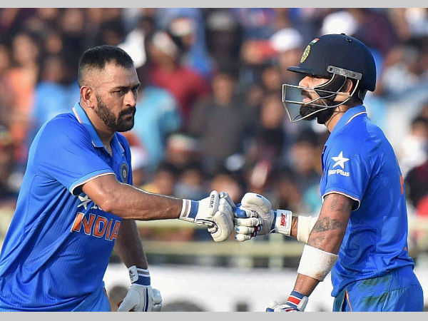 Dhoni (left) and Kohli bat together against New Zealand in a ODI on October 29, 2016. This match was Dhoni's last as captain