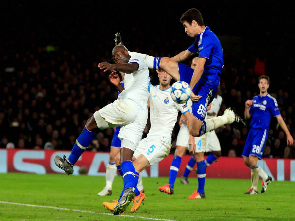 File photo: Chelsea's Oscar fights for the ball with Porto's Bruno Martins Indi (left)