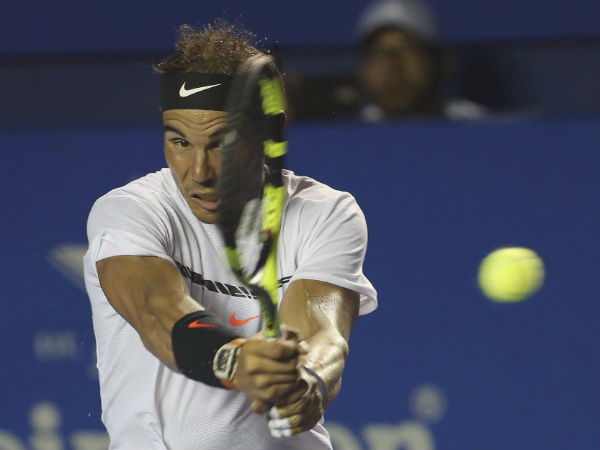 Rafael Nadal plays a return to Japan's Yoshihito Nishioka during a quarterfinal match at the Mexican Tennis Open in Acapulco.