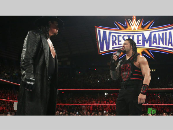 The Undertaker (left) & Roman Reigns (image courtesy WWE.com)
