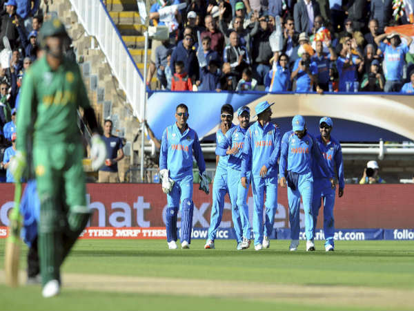 File photo: Indian players celebrate (blue jersey) as Pakistani player departs