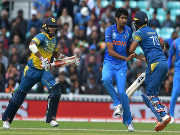 Sri Lankan players run between wickets during the ICC Champions Trophy match between India and Sri Lanka