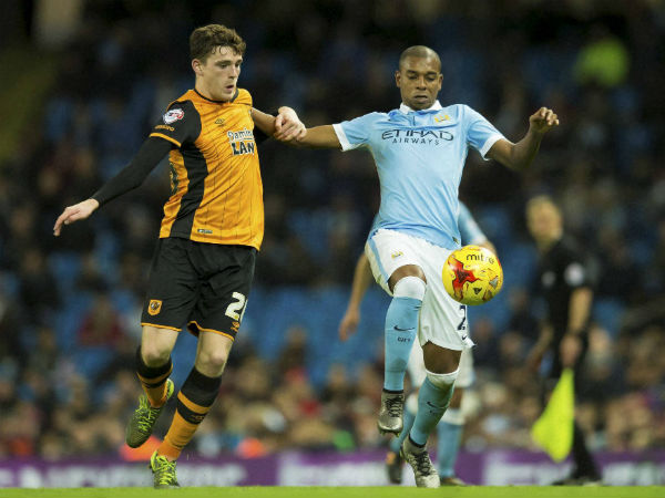 File photo: Manchester City's Fernandinho, right, fights for the ball against Hull City's Andrew Robertson during the English League Cup soccer match.