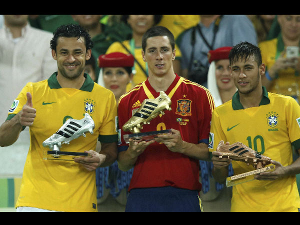 File photo: Golden boot winner Spain's Fernando Torres is flanked by silver boot winner Fred from Brazil, left, and bronze boot winner Neymar, right, after Brazil won the soccer Confederations Cup final between Brazil and Spain in 2013.