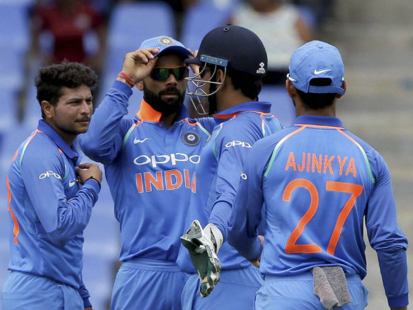 Indian players celebrate a West Indies wicket during the ODI series