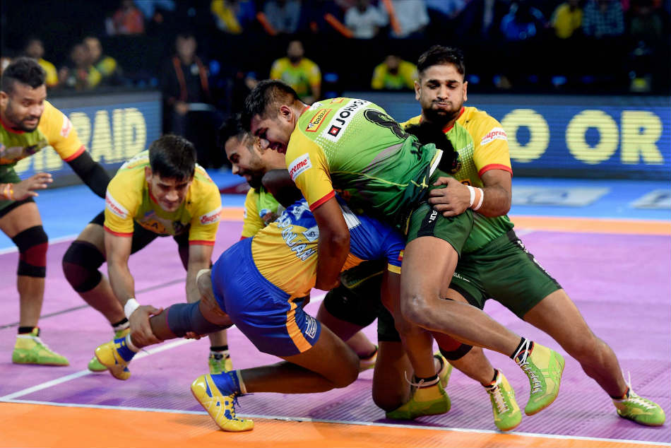 Tamil Thalaivas (Blue) and Patna Pirates(Yellow) players in action during their Pro Kabaddi League match in Mumbai on Saturday