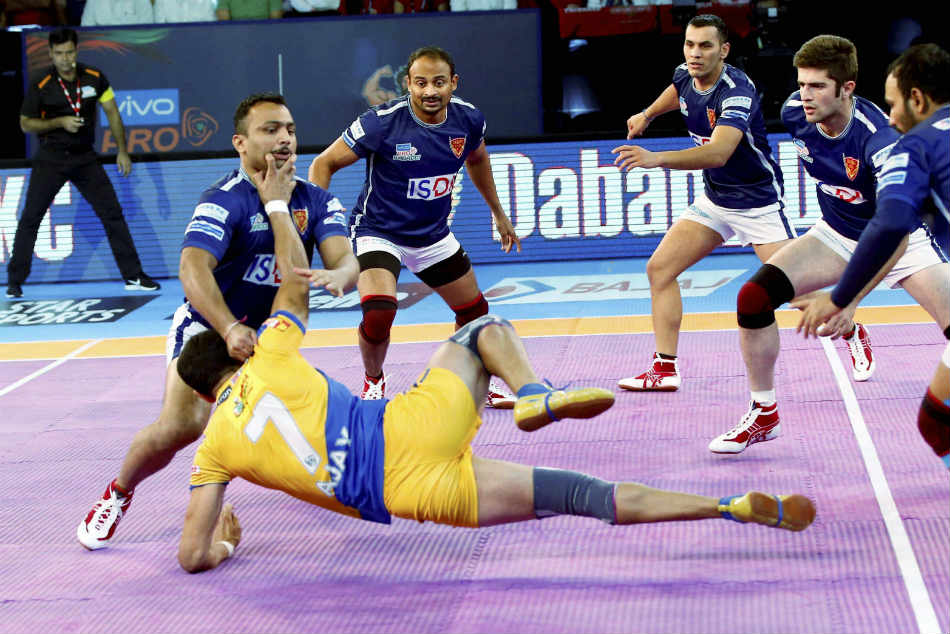 Dabang Delhi in Blue catch Tamil Talaivas in Yellow during their pro Kabaddi league in Ahmedabad.
