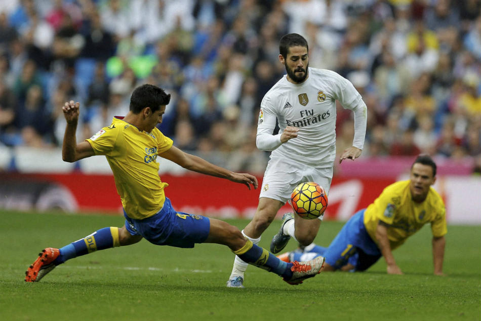 Real Madrid star Isco (centre) is also a target for Arsenal and Manchester City
